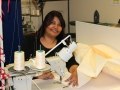 Textiles Assistant Amrit Mistry at her industrial sewing machine