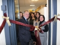Sir Albert Bore cutting the ribbon at the opening of Textiles by St Anne's new shop