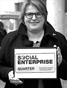 Sarah Crawley with SEUK certificate recognising the Digbeth Social Enterprise Qtr